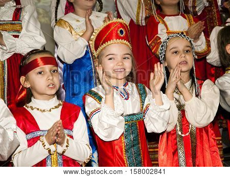 Russia Moscow - March 1 2012: Unidentified preteen little school girls in national folc costume clothes perform on Maslennitsa concert fest which signifies the end of winter