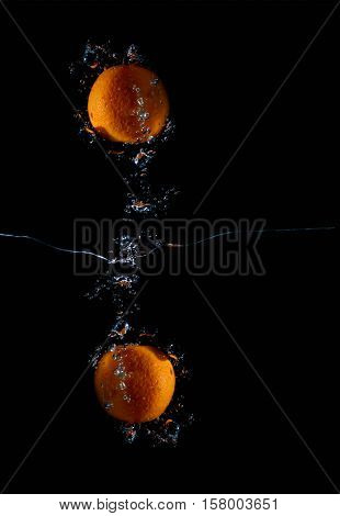 Tangerine with water splash fresh wet clear tropical symmetry
