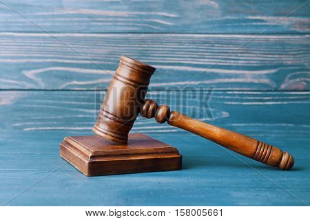 Judge's gavel and sound block on wooden wall background
