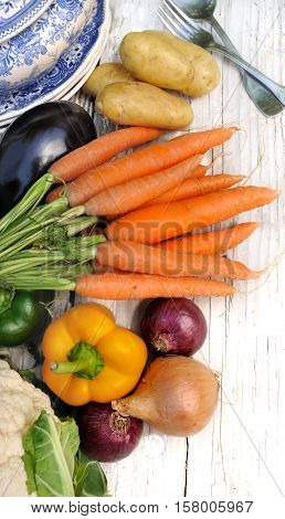 carrots and other vegetables for potage on a table