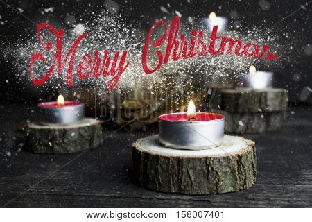Merry Christmas. Christmas Candles Burning, Decoration On Wooden Logs Resting On Rustic Wooden Backg