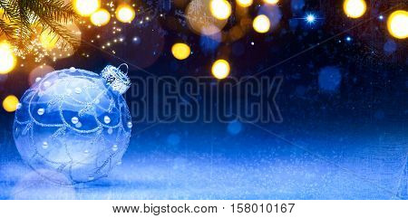 Blue Christmas background; Christmas composition with Xmas decoration on snow