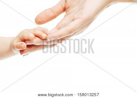 Baby's and mother's hands. Close-up. Copy space. Isolated over white background.