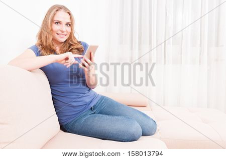 Lady Sitting On Couch Texting On Smartphone
