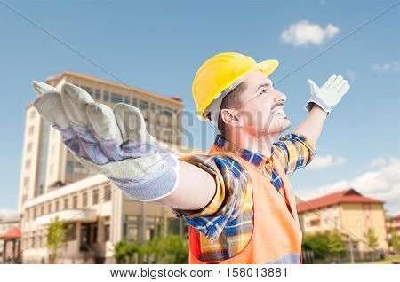 Young Engineer Or Architect Standing With Arms Outstretched