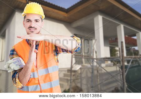 Young Architect Standing Outside On Building Site