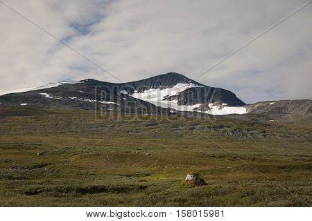 Sami shelter very old standing in the remote swedish landscape of Sarek national park