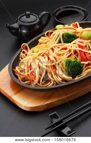 Asia Food. Udon Noodles With Vegetables On The Black Table.