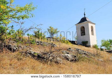 Small bell-tower built over cave monastery Old Orhei Moldova. View of old Orhei famous historical place Moldova