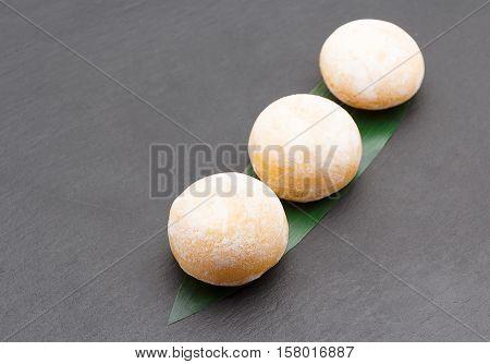 Japanese cuisine. Mochi dessert on a bamboo leaf.