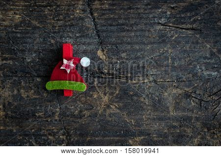 Christmas symbol winter hat on an old wooden background with place for text. Christmas decoration. Xmas time background. Winter holidays. Christmas concept. Top view. Copy space.