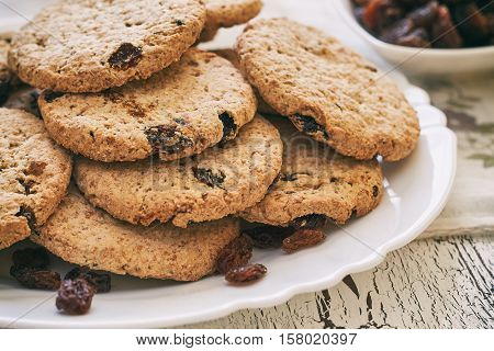 Wholewheat biscuits with raisins on white plate