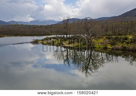 Reservoir of the Pontoon at the foot of the mountain Penalara in the Farm of San Ildefonso. Segovia Spain