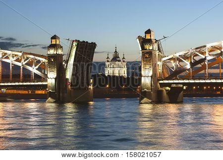 Russia. St. Petersburg. Smolny Cathedral in the opening diluted Bolsheokhtinsky bridge.