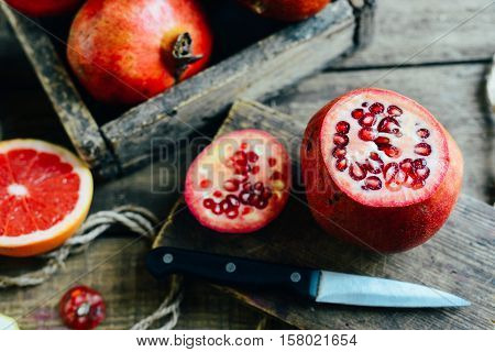Ripe Pomegranate Fruit On Wooden Vintage Background. Red Juice P