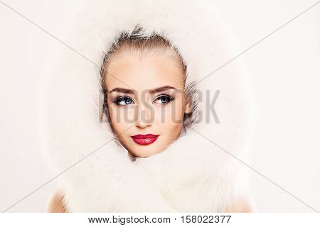 Beautiful Winter Woman Fashion Model in White Fur