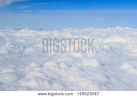 white fluffy clouds high up from a plane