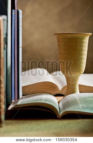 still life with chalice of wine and bible