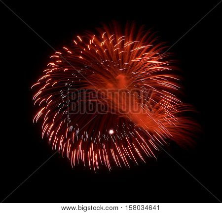 Golden orange red amazing fireworks isolated in dark background close up with the place for text, Malta fireworks festival, 4 of July, Independence day, New Year, explode