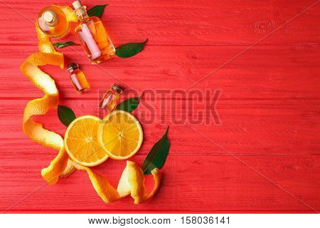 Aroma oil with citrus on red background