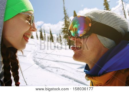 Young couple having fun with snowboards