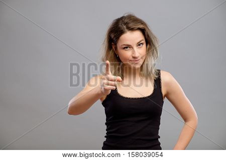 Beautiful Young Woman Pointing At The Camera