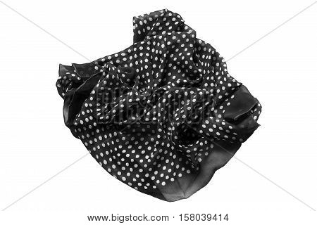 Crumpled black with white polka dots kerchief isolated over white