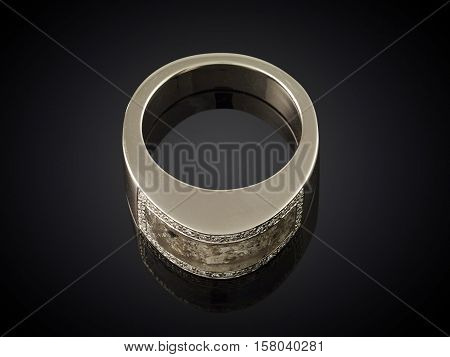Golden Ring With Ashes Isolated On Black