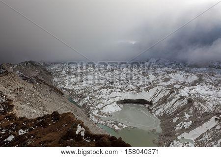 Dramatic View Over Ngozumpa Glacier And Grey Moraine Lake In Sagarmatha National Park, Himalayas, Ne