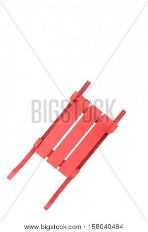 Top view of red wooden sled, isolated on white background
