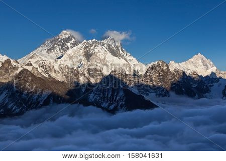 Mount Everest View From Renjo La Pass. Himalayas Mountain Valley Covered With Curly Clouds. Dramatic