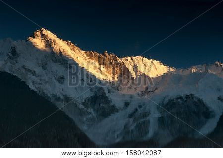 Beautiful Sunset Over Mountain Cho Oyu Reflection In The Blue Moraine Lake Mirror Surface. Picturesq