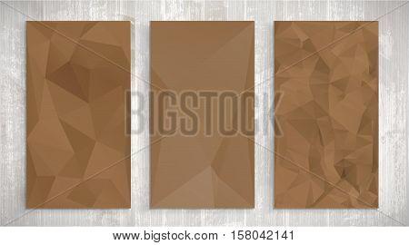 Set of tree brown wrinkled paper on light wooden background, triangular illustration