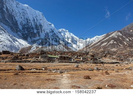 Snowy Himalayan Mountains And Nepali Village In The Everest Base Camp Area. Beautiful Landscape Of S