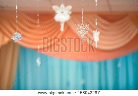 Holiday blur background with fairies and snowflake