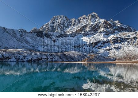 Amazingly Beautiful Himalayan Mountain Range Reflecting In The Mirror Surface Of Gokyo Lake's Transp
