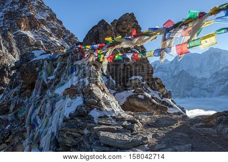 Buddhist Prayer Flags On Renjo La Pass On Three Passes Trail Route In Himalayas, Nepal. Waving Buddh