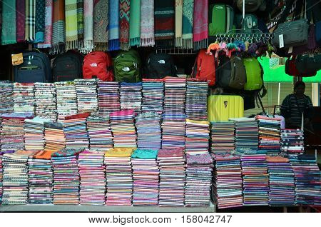 SIEM REAP CAMBODIA - OCT 22 2016: Kroma or krama (scarf) cotton khmer cloths for sale at a market in siem reapangkor in Cambodia. Cambodian textiles are very popular souvenirs for travellers.