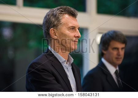 Olivos, Argentina - May 6, 2016: President of Argentina Mauricio Macri L, Finance Minister Alfonso Prat-Gay R during a press conference for the foreign press at the presidential residence.