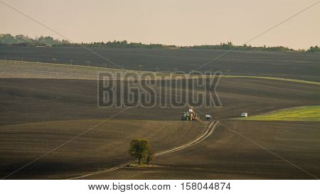 Agricultural work in the field. Landscape of Moravia.