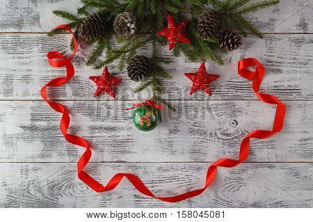 Christmas tree with red ribbon on wooden table