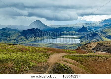 Valley National Park Landmannalaugar. Magnificent Iceland in the August. beautiful valley between the mountains and the smooth mountain lake