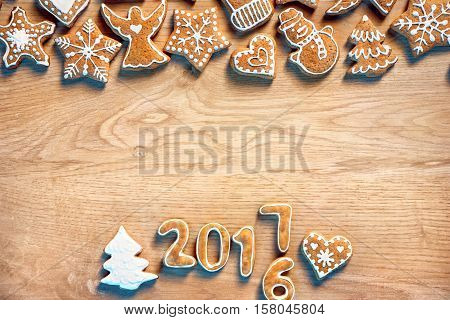 Merry X-mas! Homemade cookies on wooden background. Copy space for your text. Top view