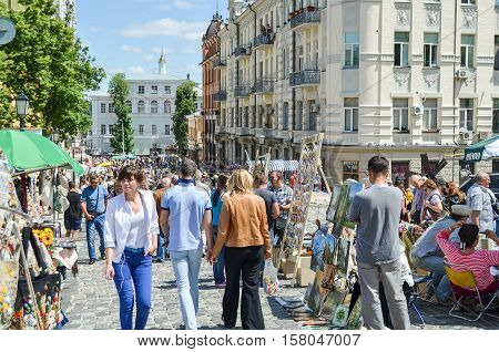 Kiev, Ukraine - June 6, 2013: Andriyivskyy Uzvoz Descent or Spusk with vendors selling souvenirs and people walking