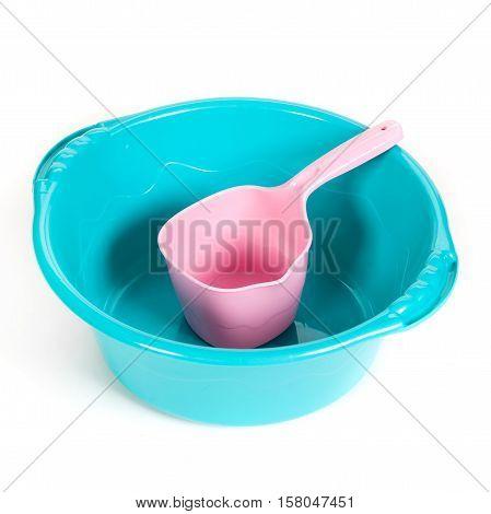 Plastic Ladle In A Basin