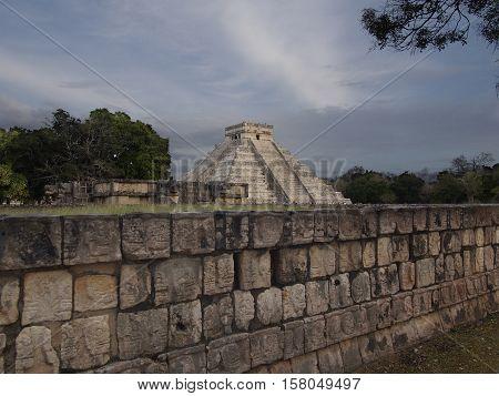 Chichen Itza Mayan pyramid with moody skies