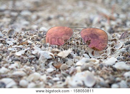 Red sunglasses on the beach focus sunglasses