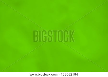 continuous smooth texture and background of paper or fabric of bright green color