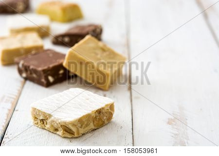 Variety of Christmas nougat on white wooden background