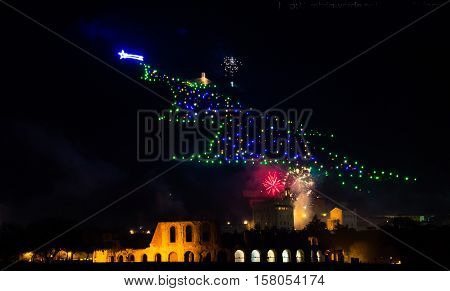 Christmas tree of Gubbio with fireworks at new year's eve